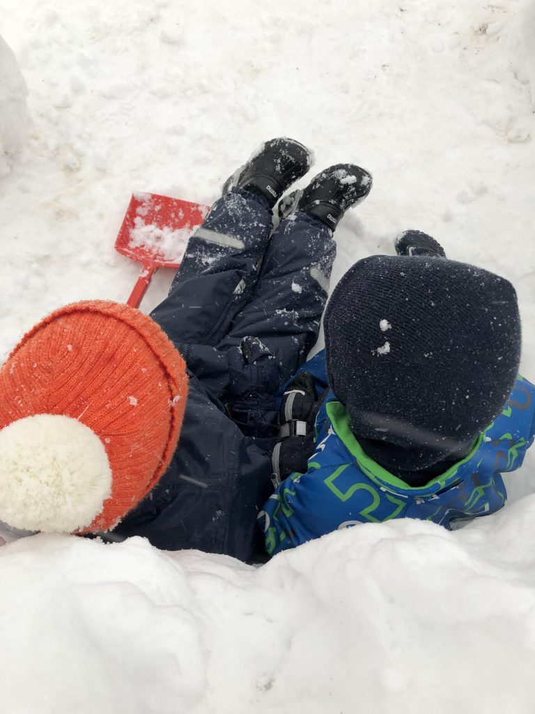Children out playing in the snow